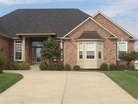 brick is similar to ours paint color is sw universal khaki door is sw superior bronze paint