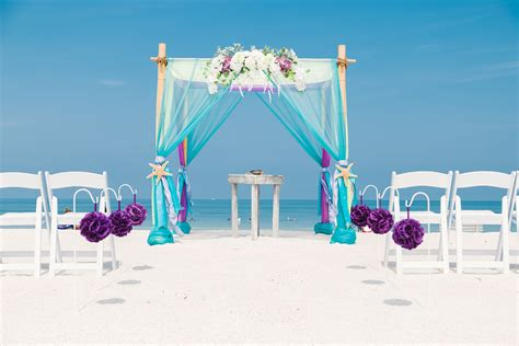 wedding planner arbor colorful turquoise and purple wedding arbor