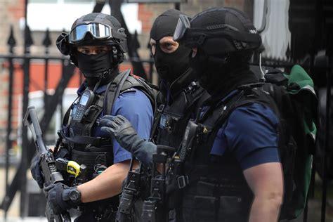 woolwich raid armed police storm flat  arrest man