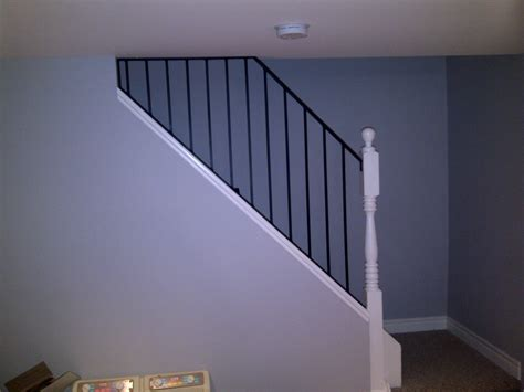 basement railing cutting edge construction