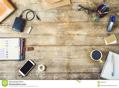 Wooden Desk Background desktop mix on a wooden office table stock photo image