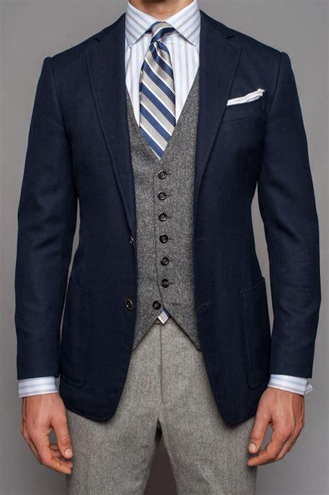 bold shorts light grey navy navy blazer grey tweed vest light grey wool blue striped tie blue and white striped