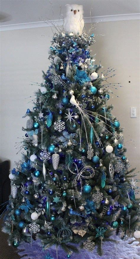 white christmas tree blue and silver ornaments