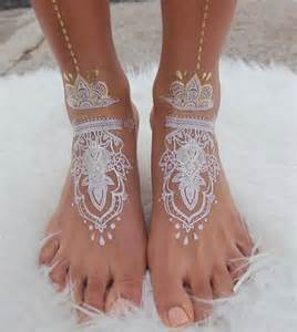 Stunning white henna like tattoos look like lace draped over skin my
