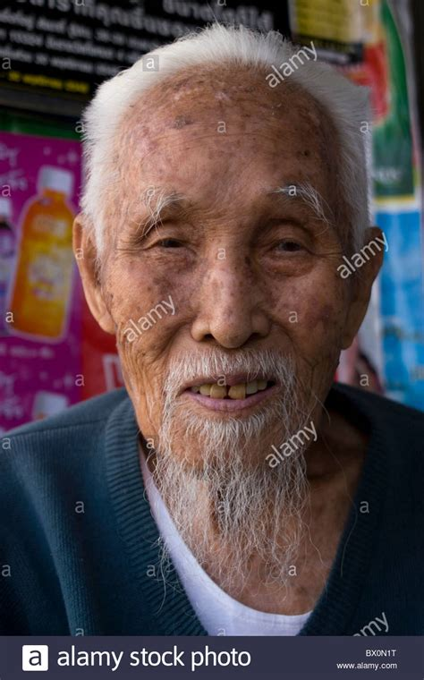 long asian goatees an elderly asian man with white hair and a long goatee is
