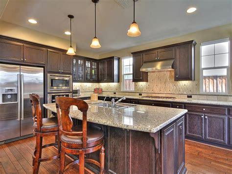 Gourmet Kitchen Island Gourmet Kitchen Large Center Island Slab Granite Pendant Lights Wood Cabinets