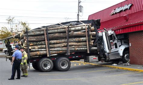 truck maine logging truck rolls maine driver then slams into