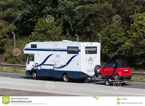 mobile home with a car on trailer editorial photo image
