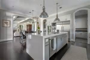 Gray kitchen island with marble waterfall countertop transitional