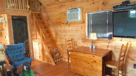 It Seems Like A Cute Wooden Tiny House. But Up The Stairs