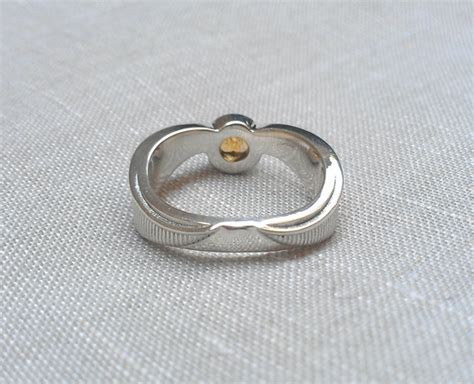 harry potter golden snitch inspired engagement ring