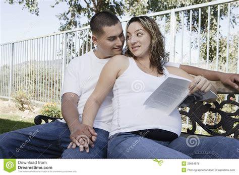 bench latin expectant couple sitting on bench royalty free stock photos image 29664678