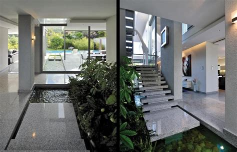 indoor water garden at foot of floating marble staircase