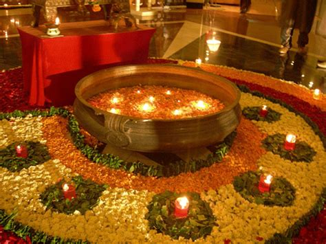 decoration of diwali in home earthen pot diyas and flowers rangoli rangoli patterns