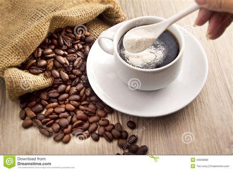 Day Kopi White Cappucinno Bag coffee bean and a spoon milk powder stock photo image 44946890