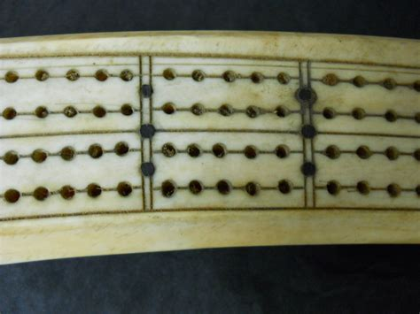 walrus tusk scrimsaw cribbage board for sale antiques