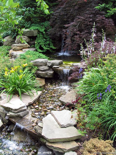 beautiful water garden interesting how it flows from a