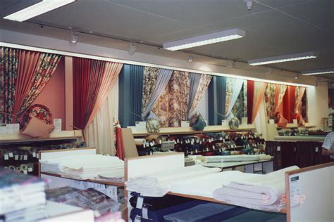 the curtain store robert sayle curtain fabric department display wall