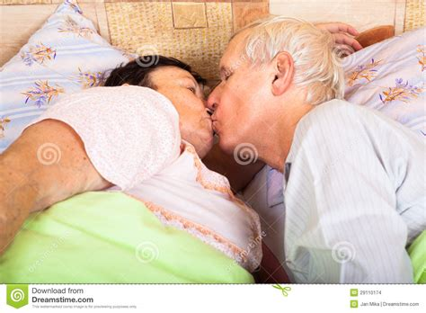 people kissing in bed loving seniors kissing in bed stock images image 29110174