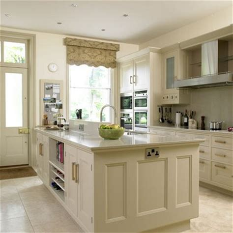 linen white kitchen cabinets beige linen colored kitchen cabinets with slightly darker counters and stainless appliances