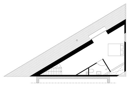 triangular floor plan barend koolhaas completes a blackened timber house with a