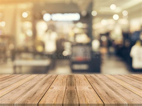 wooden board empty table blurred background perspective