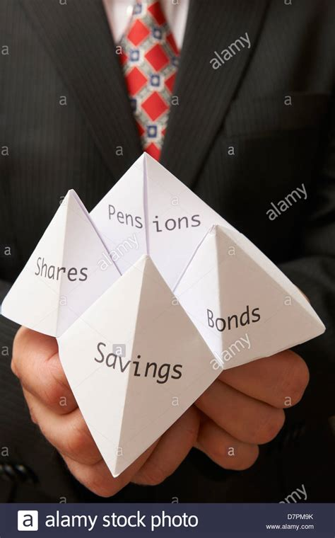 Origami Holding - business holding paper origami fortune teller with