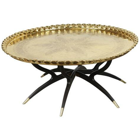 large polished brass tray coffee table on spider leg at