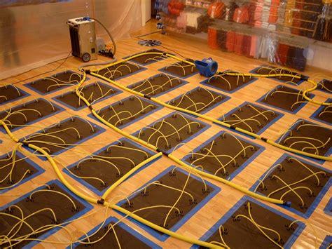 water damaged hardwood floor drying photos - Hardwood Floor Drying