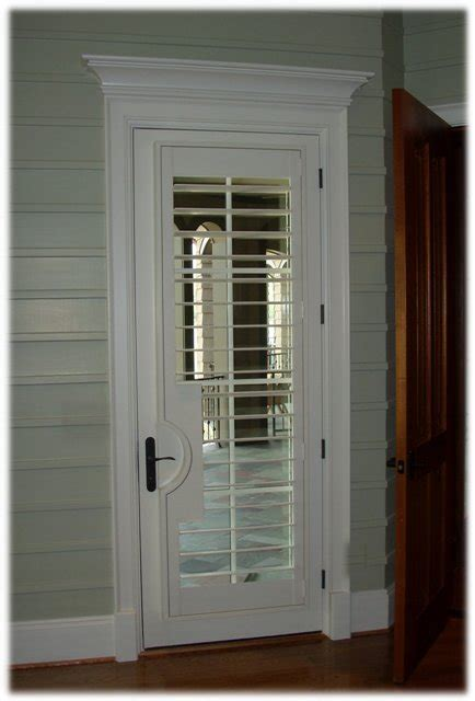 Door Shutters Interior Plantation Shutter On Door With Lever Cut Out And