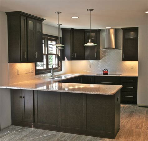 backsplash tiles for dark cabinets herringbone backsplash kitchen light granite countertops