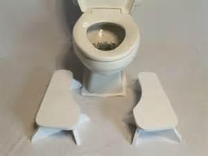 two low stoop partial squat toilet foot stool pair