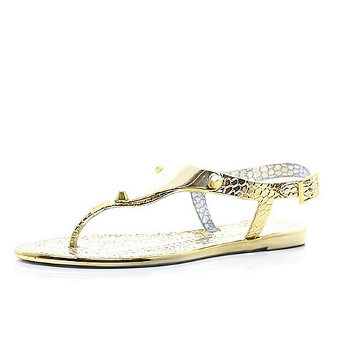 gold jelly sandals product not found