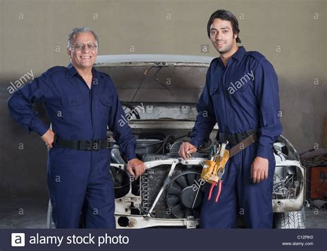 Garages Looking For Apprentices by Auto Mechanic With An Apprentice In A Garage Stock Photo