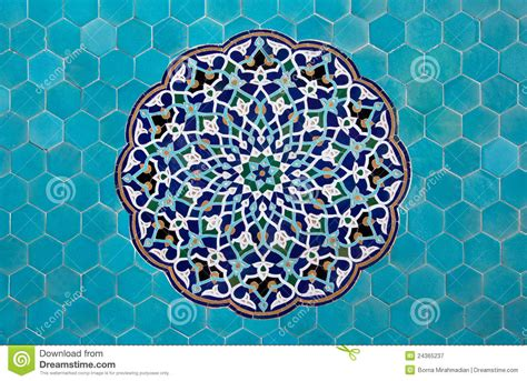 blue arabesque islamic geometric patterns inside an old islamic mosaic pattern with blue tiles royalty free stock
