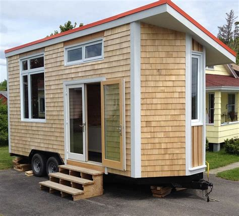 tiny homes cost tiny house on wheels cost with a simple roof line sloping