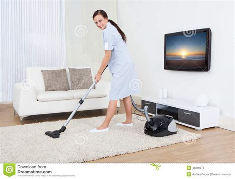 Rug Cleaning At Home by Cleaning Carpet With Vacuum Cleaner Stock Photo