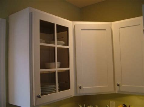 kitchen white cabinet clear glass door green wall white