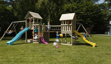 wooden swing set with bridge penthouse and kiosk combo climbing frame green hands