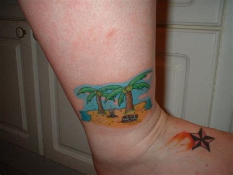 beach scene tattoo on ankle