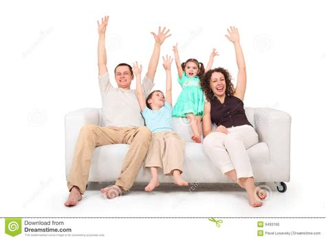 handson sofa parents and children with rised hands on sofa stock photo