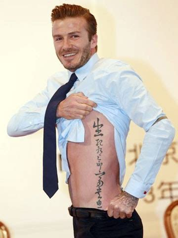 david beckham tattoo on ribs david beckham shows off hot body and huge new ribcage