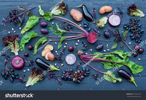 collection fresh purple fruit vegetables on stock photo