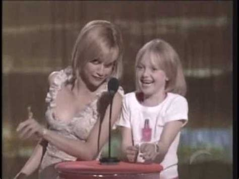 Girls Bathroom Sign by Dakota Fanning And Brittany Murphy Present An Award At The
