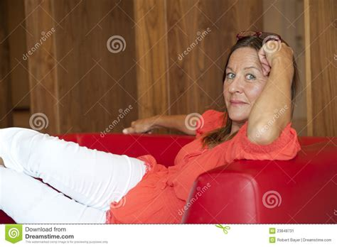 mature couch mature woman relaxed on couch stock image image 23848731