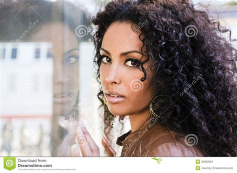 black urban hairstyles for women young black woman afro hairstyle in urban background