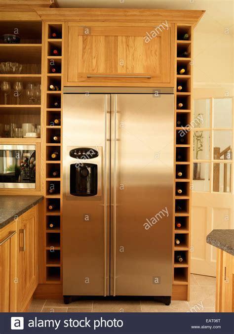 Stainless steel fridge and built in wine rack storage in