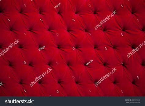 red velvet couch background texture sunken stock photo