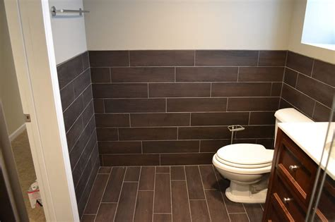 tile on bathroom walls floor tile extends to wall bathrooms pinterest in