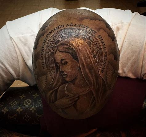 photo rapper yg tattoos the virgin mary on his head